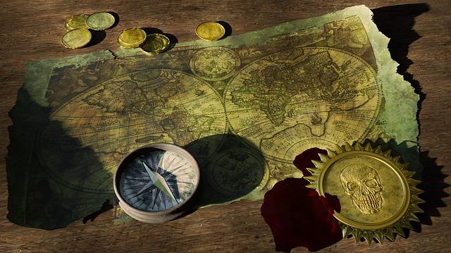 stará mapa světa a kompas
